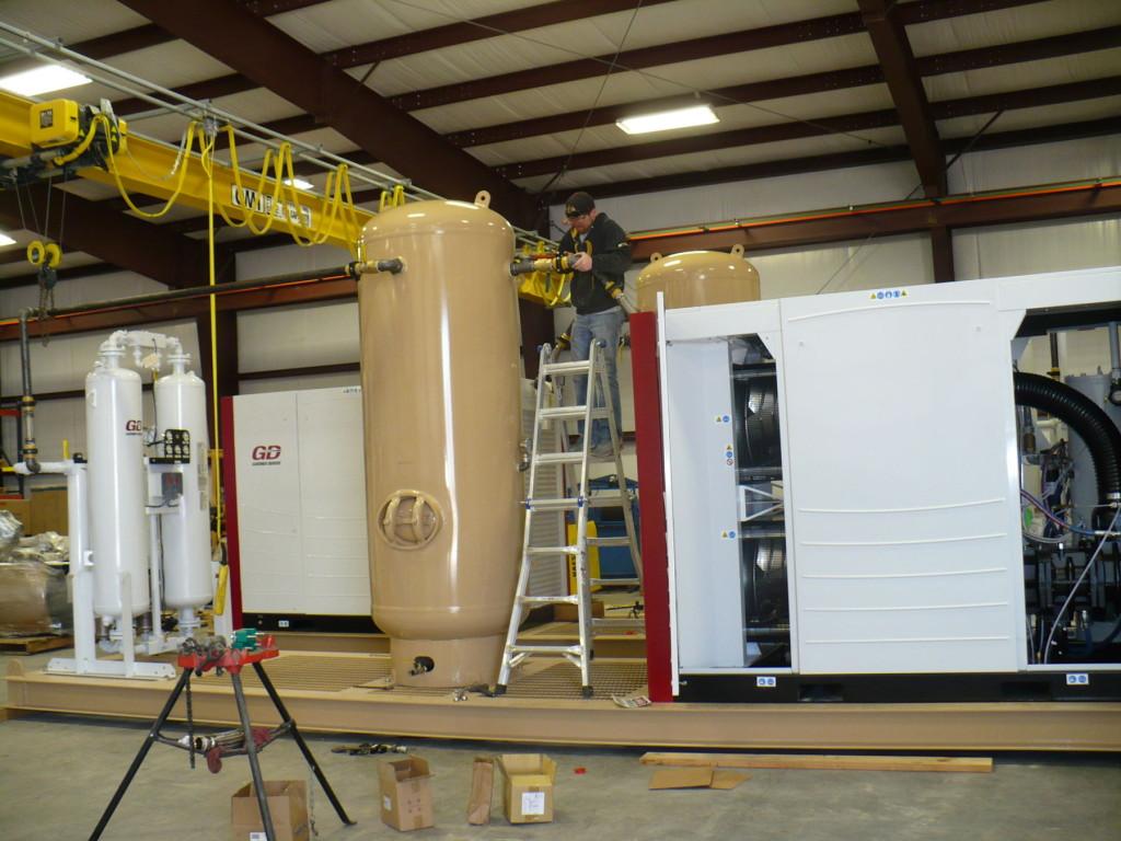 Fitz Equipment- Engineer working on industrial air compressor